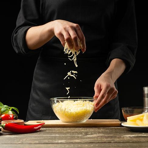 The chef prepares mozzarella cheese, che