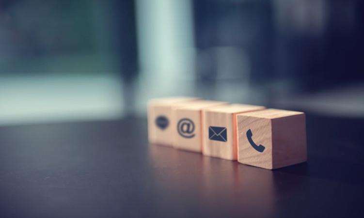 contact-us-concept-wood-block-symbol-tel