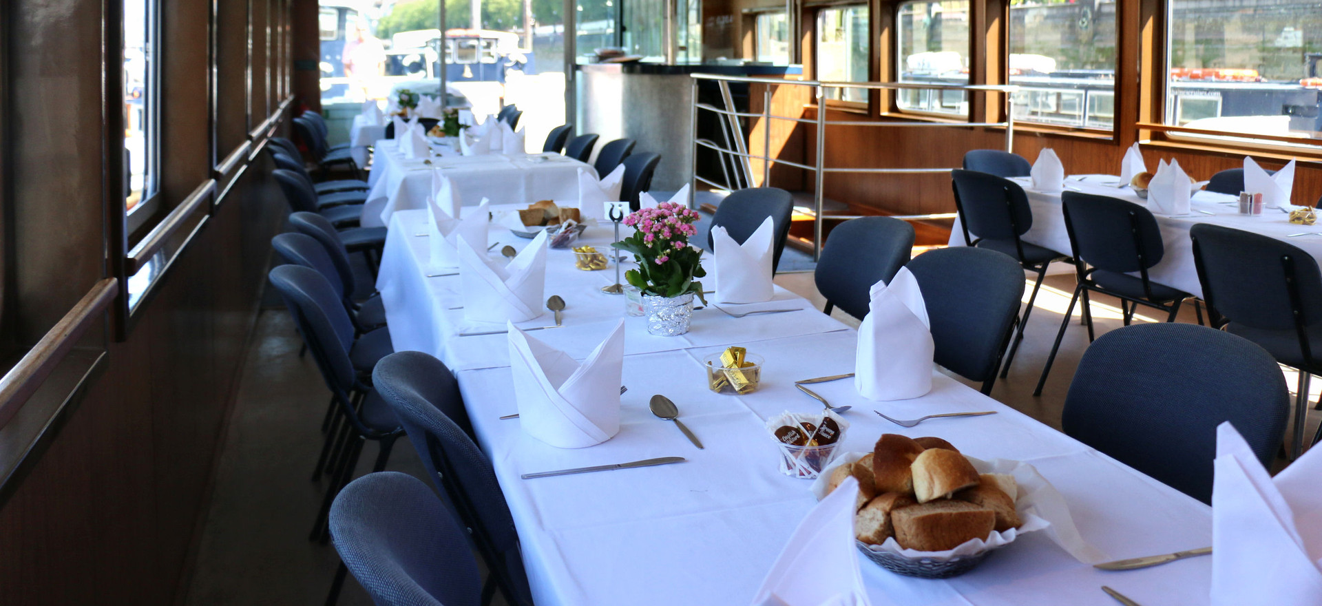 Formal dining on a Thames River party boat