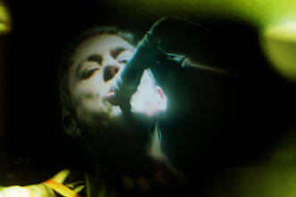 Jamie Hince of The Kills photo by Corgam. Experimental photography. Lens distortion. Concert photography.