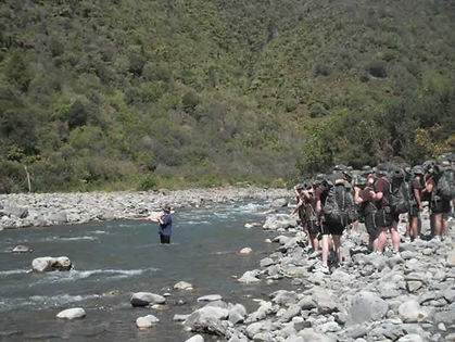 youth cross a river