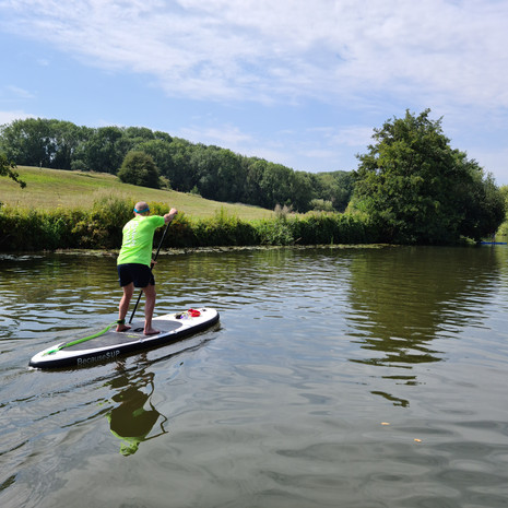 """""""We had a lesson 2 weeks ago and thoroughly enjoyed ourselves. Helen was very professional, reassuring and full of tips and tricks. We were so enthused we have now bought our own board and are putting all her good advice to use. We are both over sixty. Whoever said that you can't teach an old dog new tricks!"""" - Kevin and Denise M"""