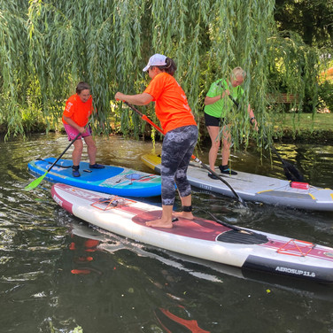 """""""I booked a lesson with Angela with 2 other friends! We are hooked! Angela was careful to explain everything we needed to know and I felt very safe and confident. It started to thunder so we had to cut short the lesson, but she was happy to reschedule to get our full 2 hours. We were taught all the basics of SUP and were then confident enough to venture out on our own! Thank you for giving us a new hobby! I strongly recommend giving this a go!"""" - Helen P"""