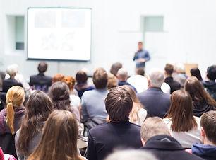 Speaker Giving a Talk at Business Meetin