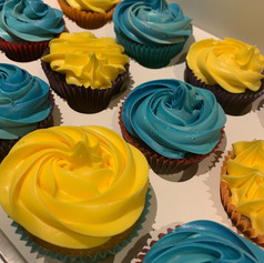 Yellow and blue cupcakes .jpg