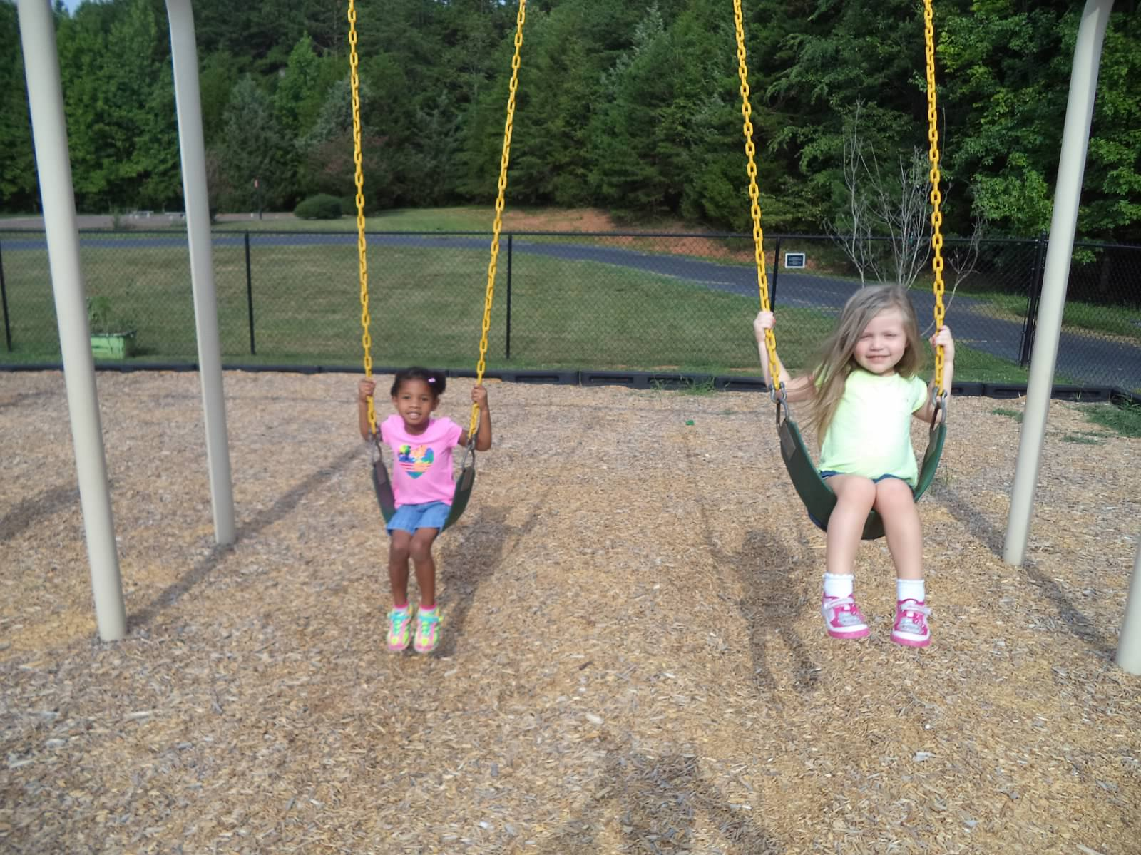 teagan and emily on swings