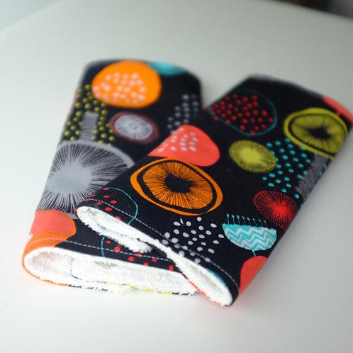 Geometric Flowers on Black Strap Covers