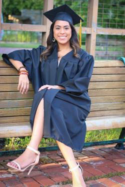 girls poses for high school grad
