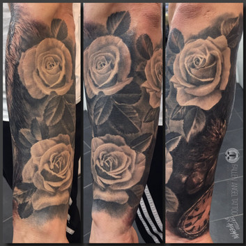 Roses on arm. Backside of the gorilla with a pocket watch. Done at Fallen Angel Tattoo in Gävle, while I worked there.