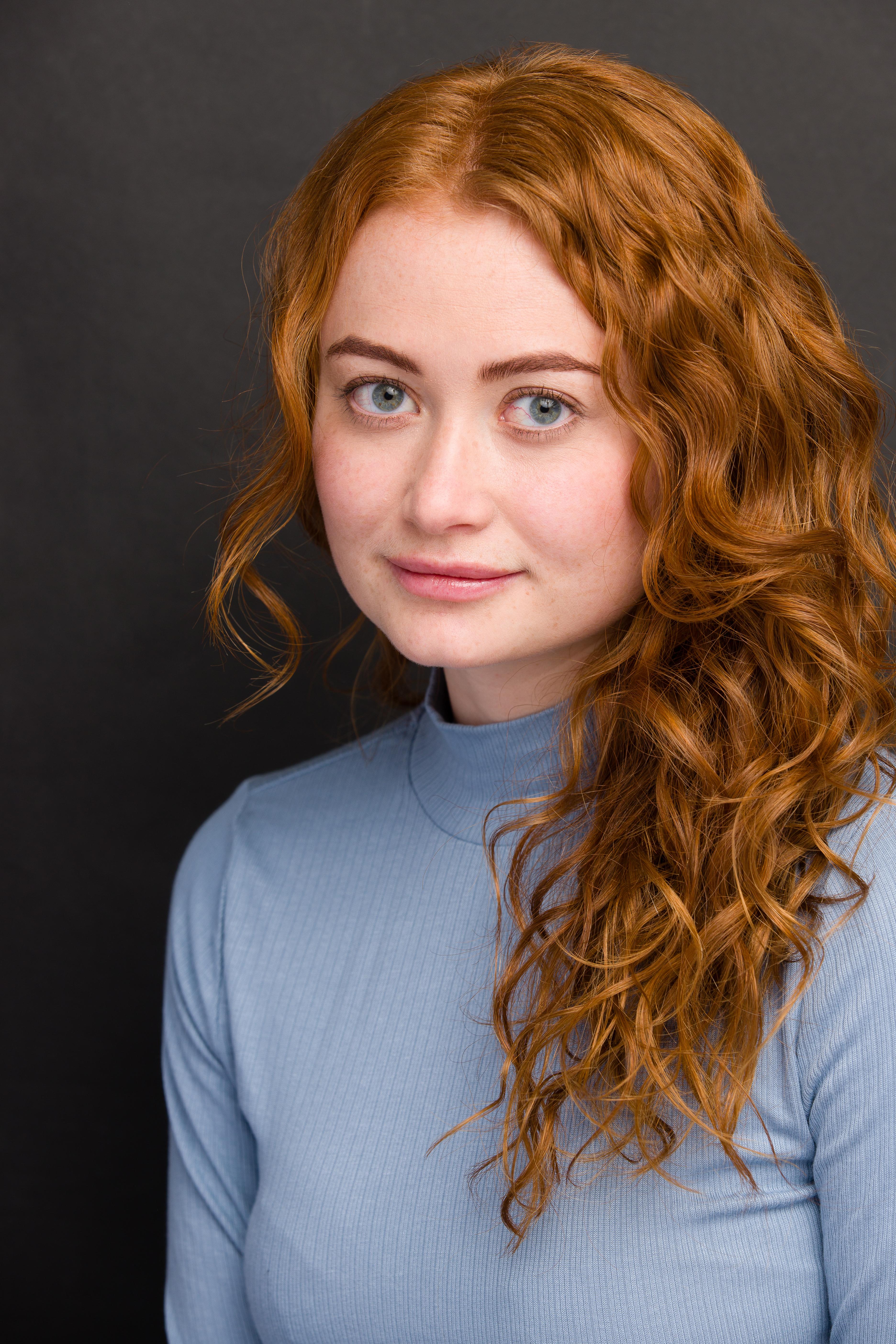 Rachel Oremland headshot-Blue