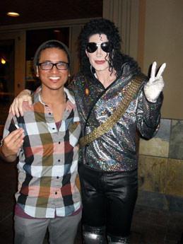 DevasMJ posing with a fan