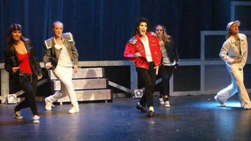 DevasMJ dancing red jacket with backup dancers