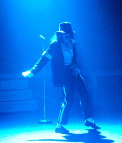 Dev as MJ dancing in blue lighting
