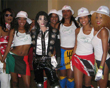 DevasMJ posing with a group of wimen
