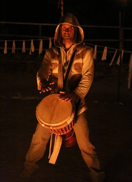 Playing Drum at Fire Circle