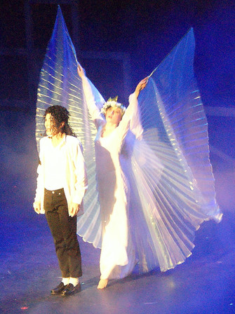 Michael Jackson Impersonator performing a song with a dancer behind with Isis Goddess Wings