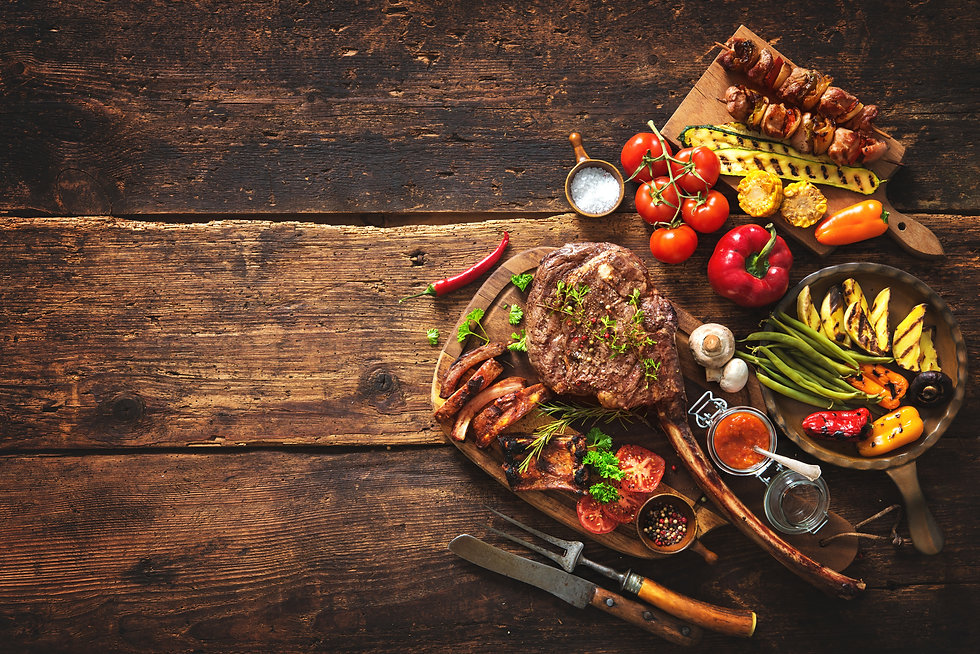 Grilled meat and vegetables on rustic wo