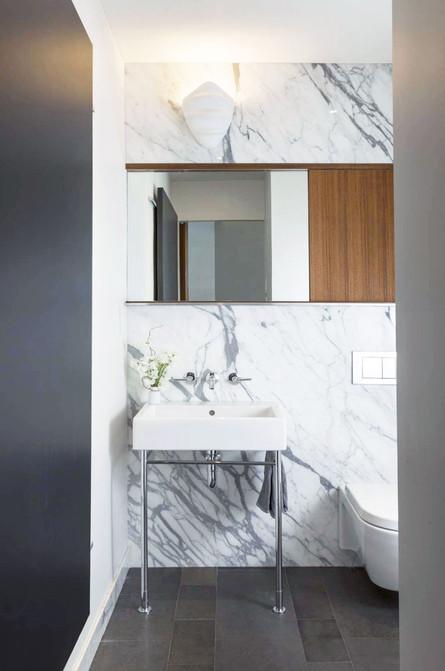 Noho-triplex-powder-room-marble.jpg