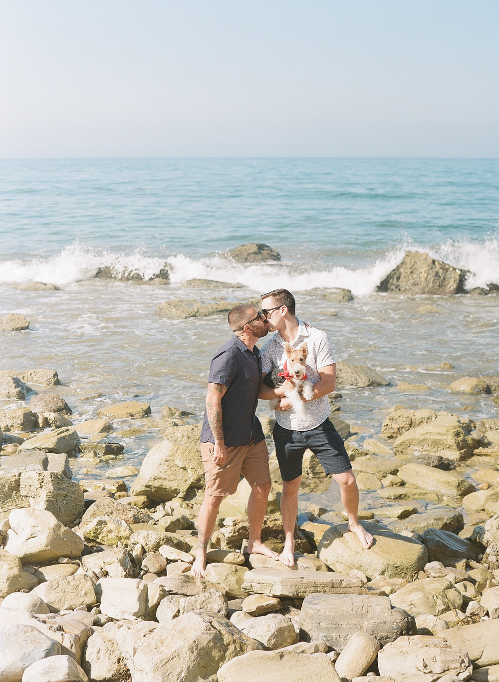 Gay couple kissing at Palos Verdes beach gay family portraits on film