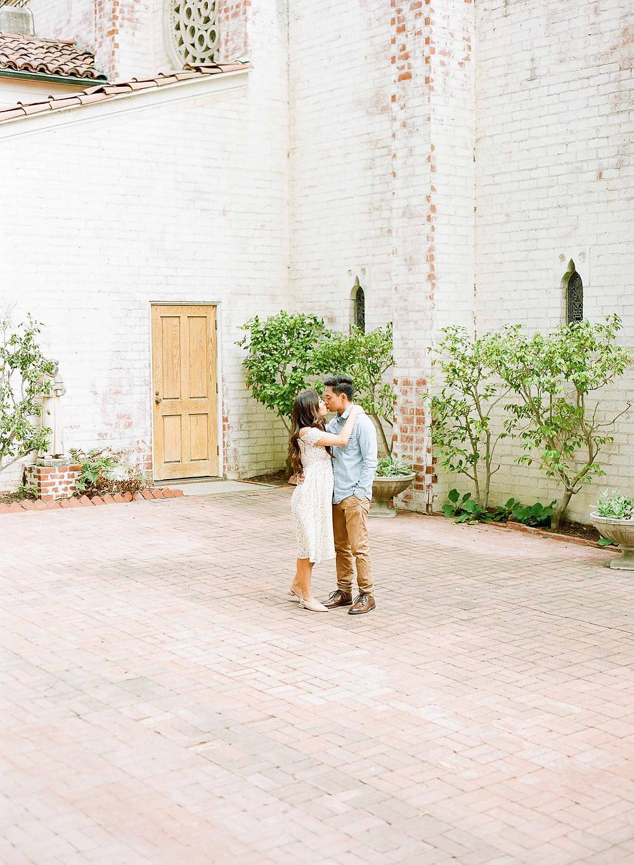 Palos Verdes Pregnancy Announcement Couple Kissing
