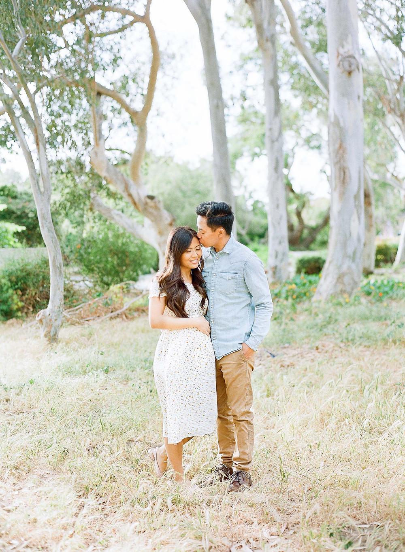 Palos Verdes Man kissing Wife's Temple Pregnancy Announcement