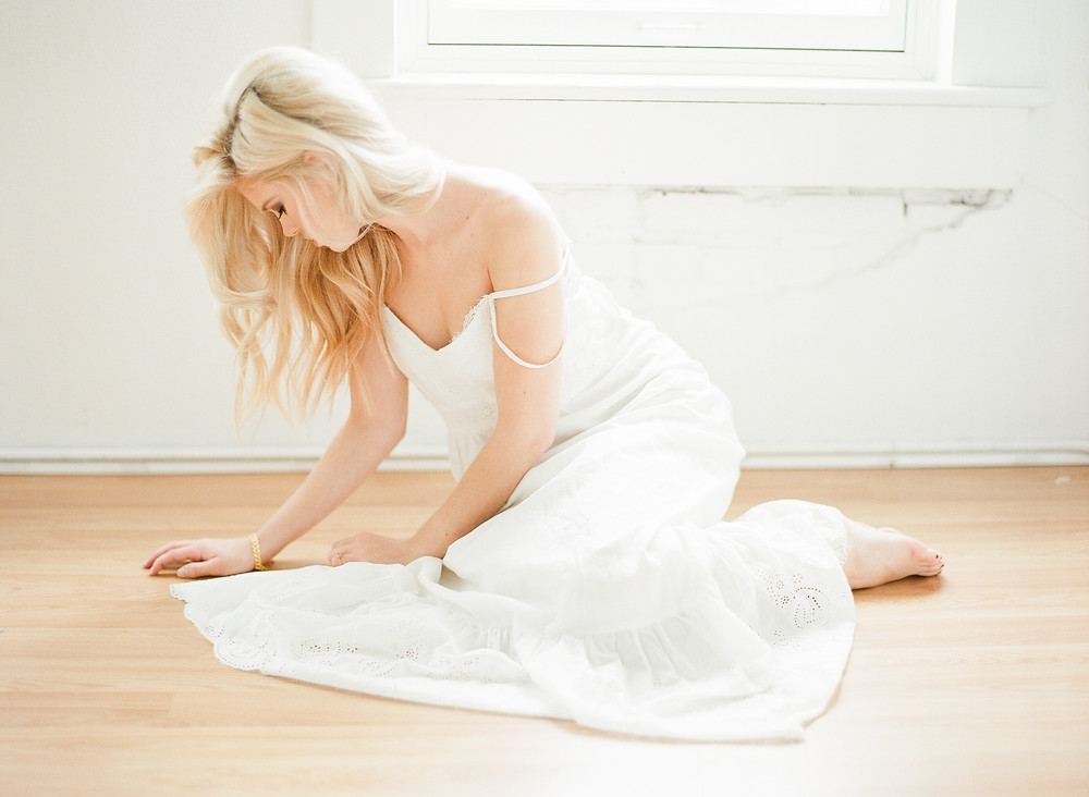 Woman wearing white lace dress boudoir photography
