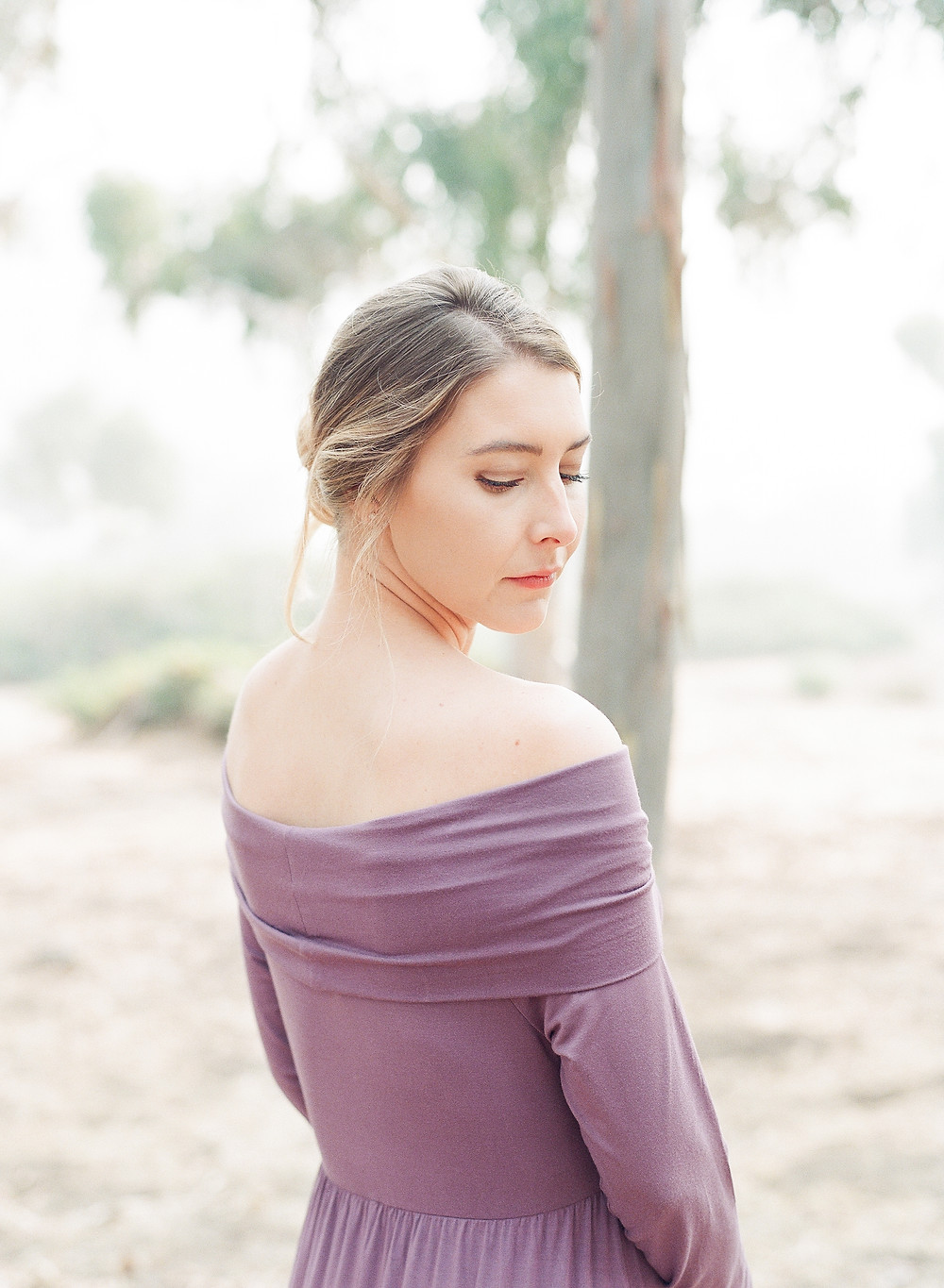 Maternity photos in california woman looking over shoulder