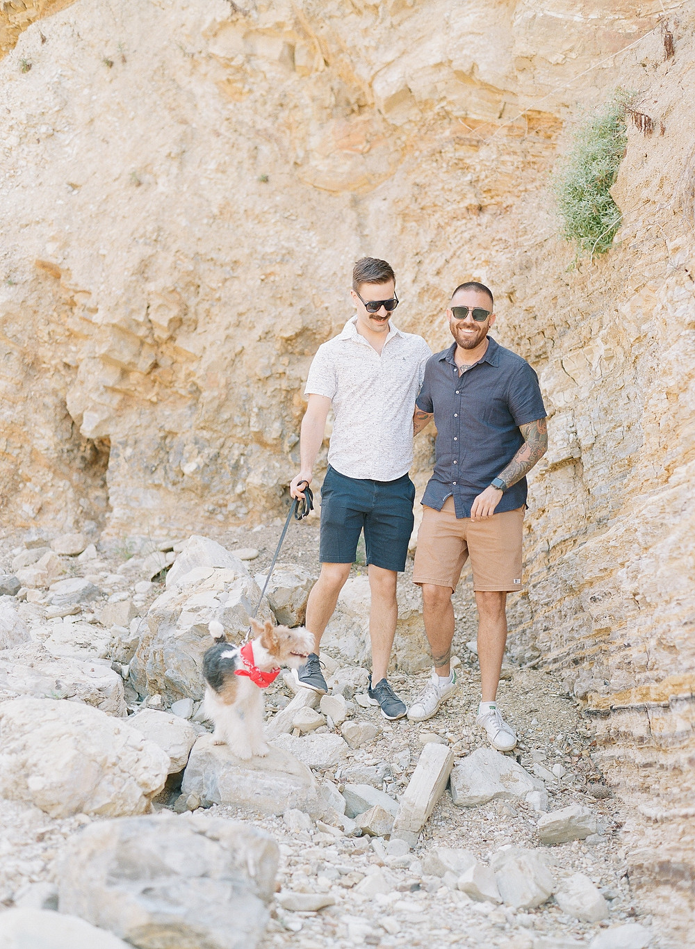 Gay couple smiling during family portraits on film at Palos Verdes