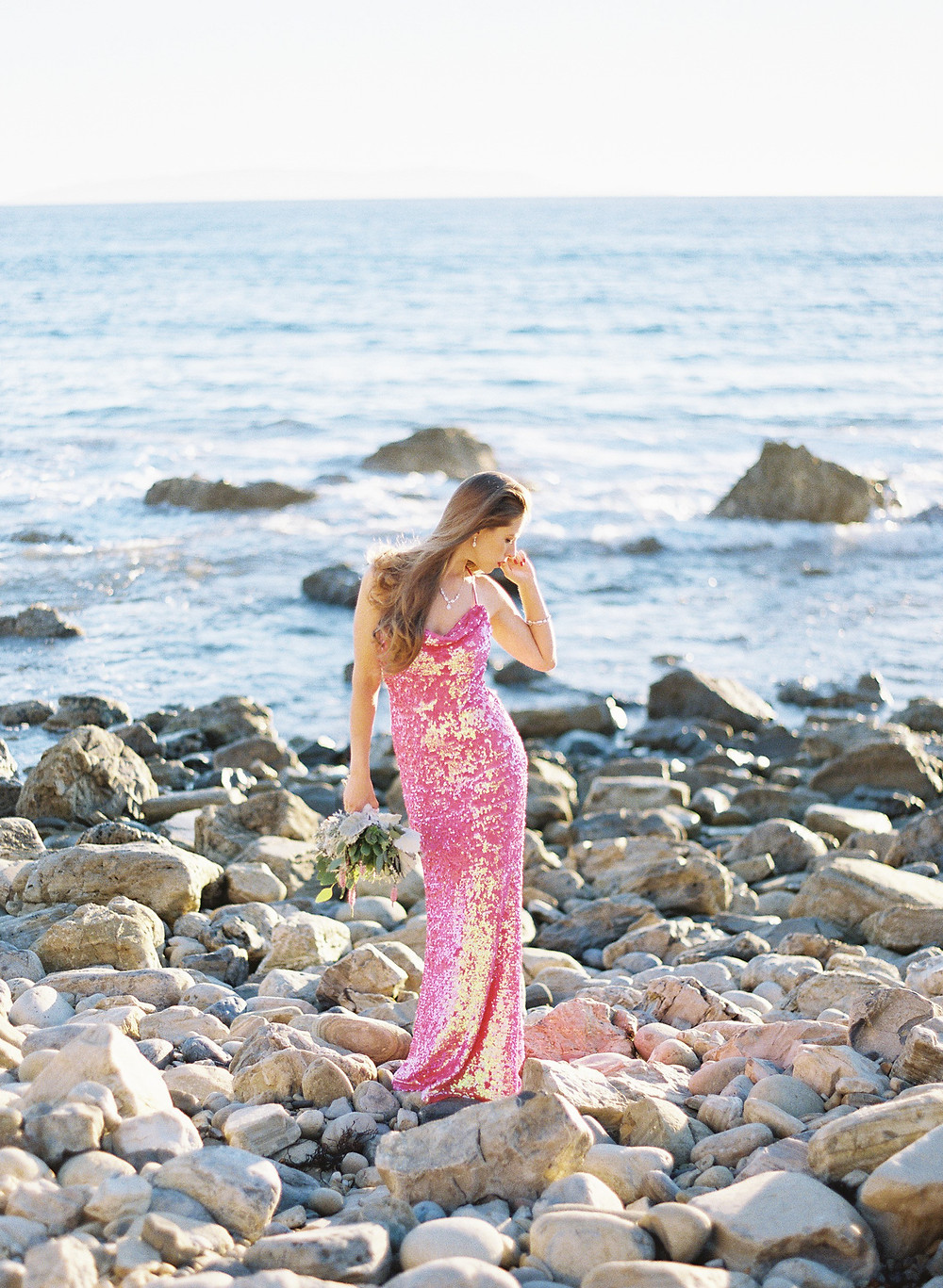 Portrait photography on film of woman wearing pink sequin dress in Palos Verdes