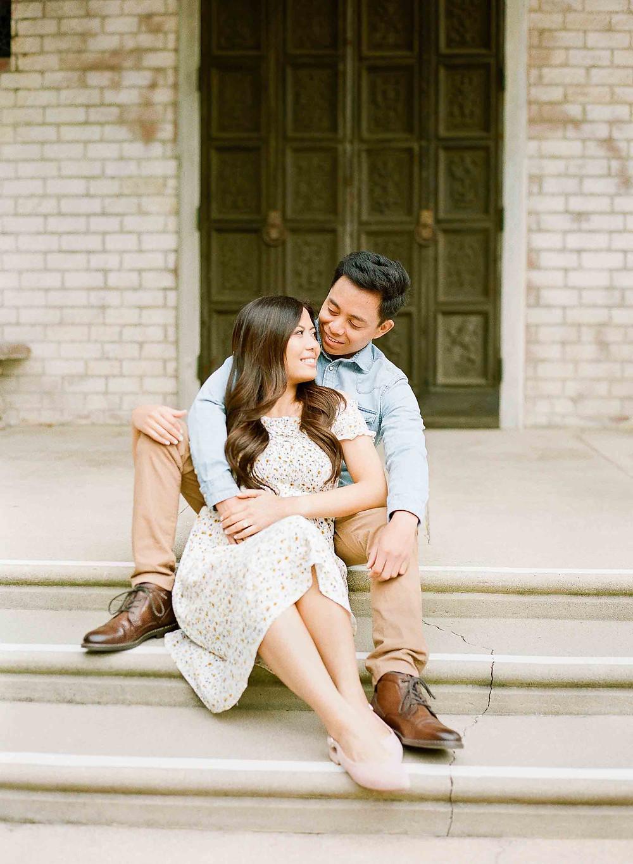 Palos Verdes Pregnancy Announcement Couple Sitting on Steps