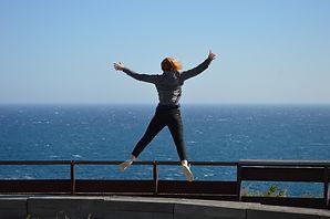 girl jumping by sea.jpg