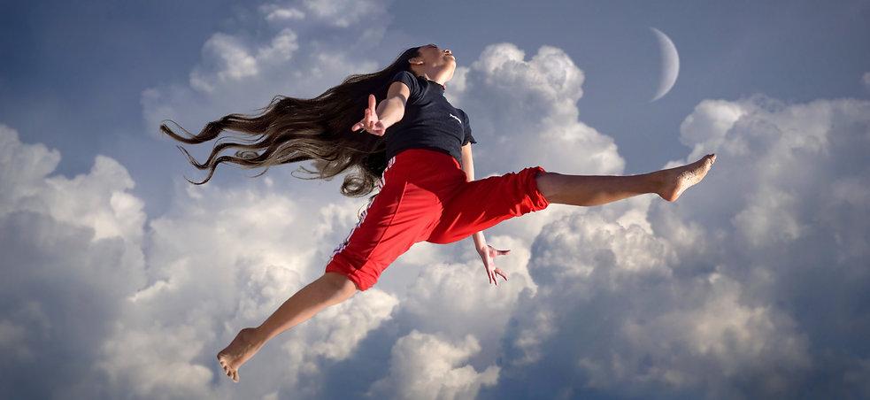 girl-jumping in clouds.jpg