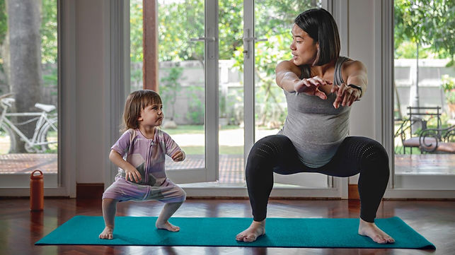 pregnant_mom_squatting_and_exercising_wi