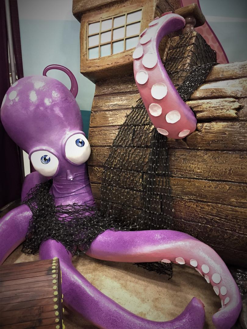 closeup octopus and shipwreck