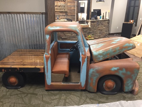 rusty truck in lobby with barnyard theme