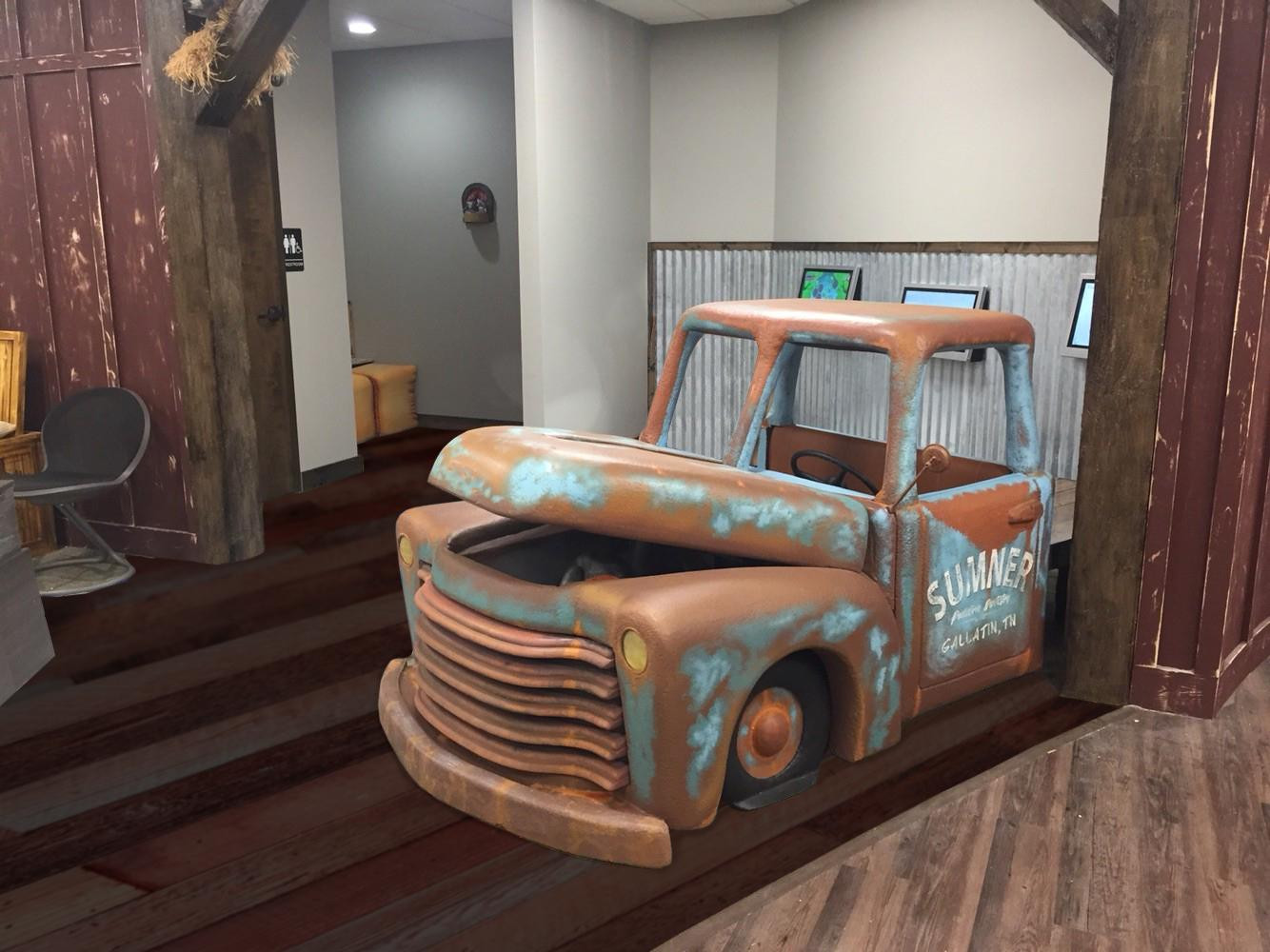 Rusty truck in lobby with barnyard theme