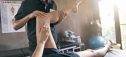 physio examining knee.webp