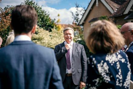Photographer Wedding Birmingham, wedding guests chatting at the lord leycester warwick