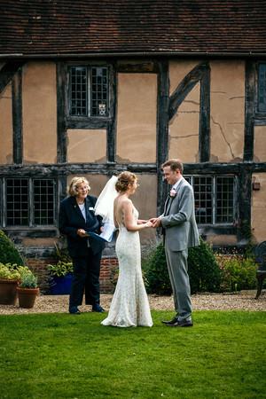 Lord Leycester Warwick wedding, bride & groom exchanging vows outdoor wedding, photographer wedding birmingham