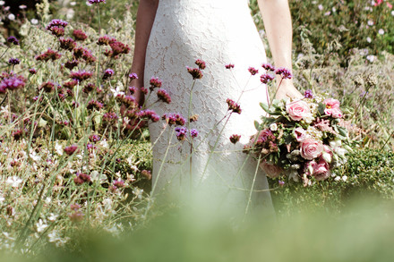 solihull wedding photography, the bride in the flower garden at the lord leycester hospital wedding venue Warwick