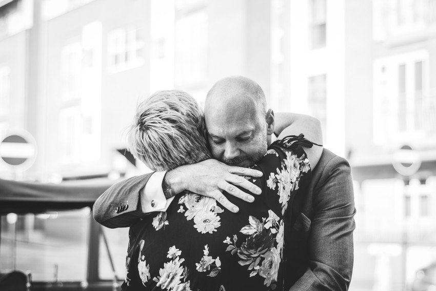 Civil Wedding Photographer Birmingham, the groom embracing one of the guests, nice candid photograph