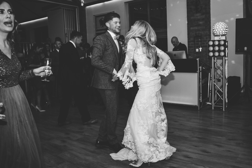 Wedding Photographer Birmingham, the bride & groom dancing to their first dance at Wootton Park Henley in Arden