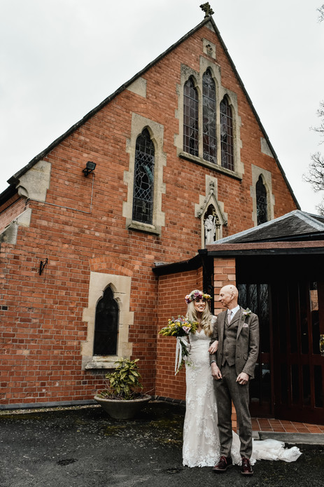 Birmingham wedding Photographer, the bride & her father just before the ceremony at a catholic church in Warwickshire