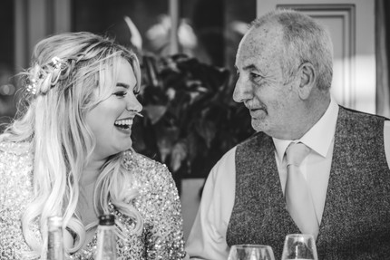 Hampton Manor Informal wedding Photographer Solihull, guests chatting at a wedding reception, black & white fun photograph