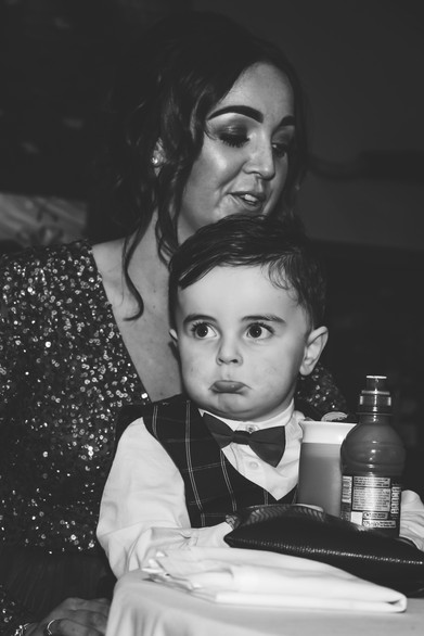 Solihull wedding photographer, little boy bored during the speeches at a wedding at wootton park Warwickshire