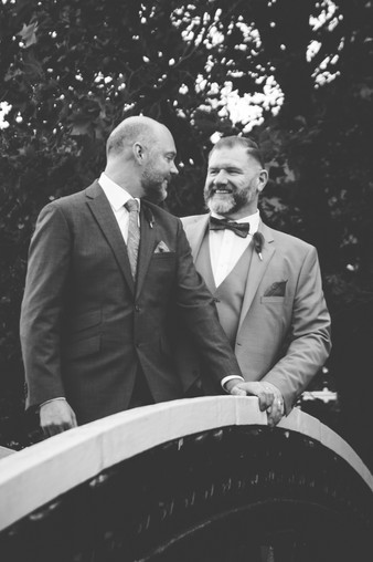 Civil Wedding Photographer Birmingham, informal photograph of the grooms looking at each other, black & white natural photograph