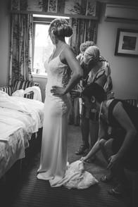 Birmingham wedding photographer, informal wedding photographer, bride getting into her wedding dress being helped by her mum & friends at Westmead hotel Birmingham