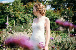Photographer wedding Birmingham, the bride in the flower garden at the lord leycester hospital Warwick