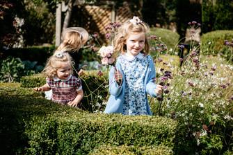 Photographer wedding Birmingham, flower girls running through the gardens at the lord leycester hospital wedding venue