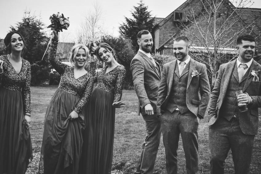 Wedding Photographer Birmingham, bridesmaids & ushers doing a funny pose at their friends wedding at Wootton Park Warwickshire